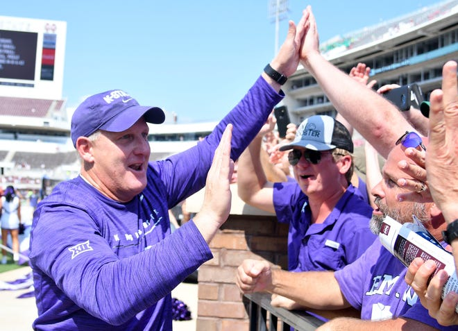 Kansas State Wildcats head coach Chris Klieman celebrates with fans after a road win over Mississippi State last season. Klieman has agreed to a contract extension with K-State through the 2026 season.
