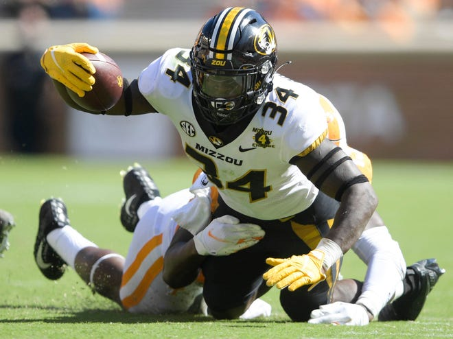 Missouri running back Larry Rountree III (34) reaches for extra yardage in the fourth quarter of Saturday's game at Tennessee. Tigers coach Eli Drinkwitz said his plan is to get the senior more carries in upcoming games after early deficits limited his carries in losses to No. 2 Alabama and No. 21 Tennessee.