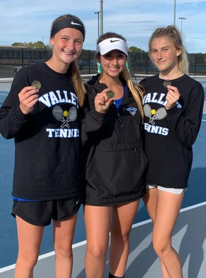 Grain Valley doubles team partners Finley LaForge and Chelsea Gorden and singles player Kennedi McCord, from left, show off their medals after earning a berth at the Class 2 state tournament with top two finishes at Friday's individual district tournament..
