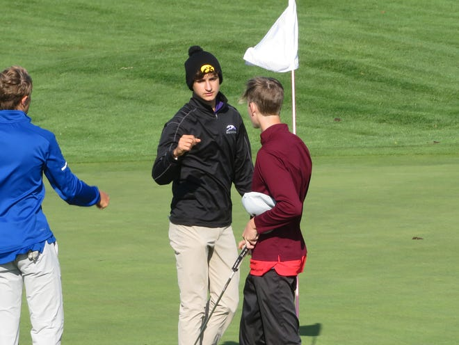 Burlington High School sophomore Mateo Rascon (center) congratulates his playing partners following Monday's Class 4A district golf tournament at Glynns Creek Golf Course in Long Grove.