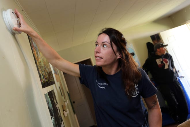 In this file photo, Burlington firefighter Jesse Teeter installs one of two smoke detectors in the living room of a Burlington home. The Burlington Fire Department and Burlington Elks Lodge #84 are sponsoring a free, drive-through distribution clinic for homeowners needing a smoke detector. The distribution will be from 9:30 to 11:30 a.m. this Saturday and Oct. 17 in front of the Elks Lodge at 215 N. Fifth St. in downtown Burlington.