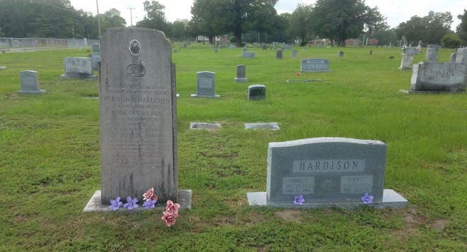 A monument at the resting place of Vernon Perry Hardison, a fallen World War II soldier from Lenoir County, stands tall next to the grave of his mother and father at the Maplewood Cemetery in Kinston, N.C.