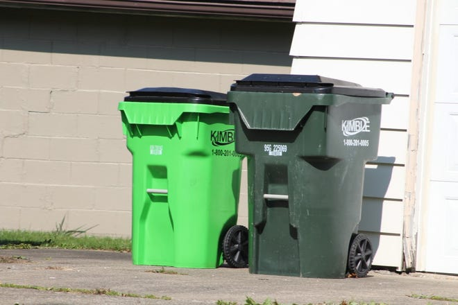 Kimble trash will be the new haulers in Tallmadge. A bright green cart is for recyclables.