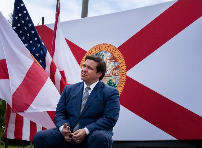 Florida Gov. Ron DeSantis listens to President Donald Trump speak at the Jupiter Inlet Lighthouse and Museum on Sept. 8.