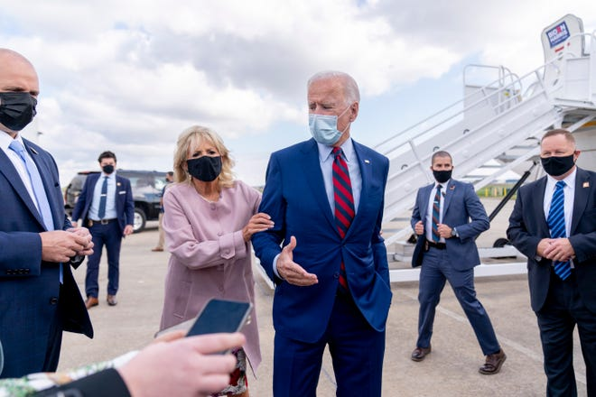 Jill Biden moves her husband, Democratic presidential candidate former Vice President Joe Biden, back from members of the media as he speaks outside his campaign plane at New Castle Airport in New Castle, Del., Monday. Biden left his home state to travel to Miami for campaign events.