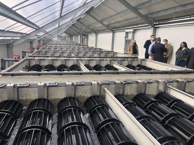 Visitors tour the new Algaewheel sewage treatment plant in Naples.