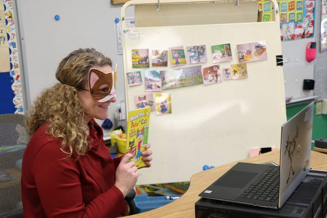 "Canandaigua kindergarten teacher Julie Marie Smith uses a ""Pete the Cat"" book to teach virtually."