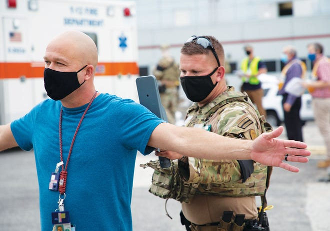 From taking responders' temperatures to masks and social distancing, precautions ensured the Y-12 emergency management exercise was conducted safely.