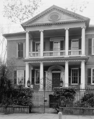 The front facade of the historic Miles Brewton House in Charleston today looks much as it did in this 1937 photograph by Frances Benjamin Johnston. [Carnegie Survey of the Architecture of the South, Library of Congress, Prints and Photographs Division]