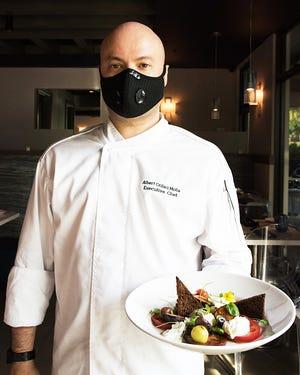 Acqua Cafe executive chef Albert Crifaci Molla with his fall-inspired tomato carpaccio with straciatella and caramelized figs.