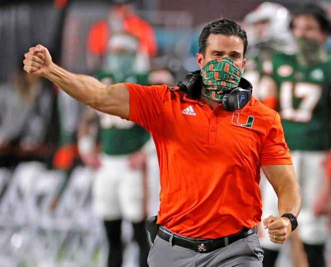 Coach Manny Diaz celebrates a touchdown in Miami's win over Florida State at Hard Rock Stadium.