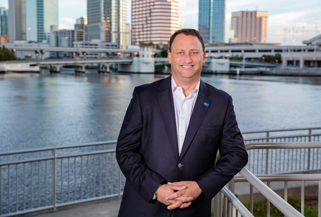 John Couris, president and CEO of Tampa General Hospital, photographed overlooking the Tampa skyline in September 2018.