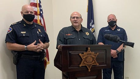 Iberville Parish Sheriff Brett Stassi is seen with State Fire Marshal Butch Browning and Plaquemine Police Chief Kenneth Payne during a press conference to announce the arrests made in recent shootings in Plaquemine and White Castle.