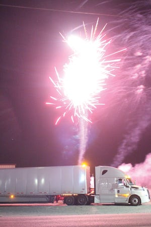 Fireworks explode behind lines of big trucks at the 2020 Hot & Cold Big Truck Show in Pratt. More than 88 big rigs came to town on Saturday, October 3 and parked at Southwest Truck Parts property on the northeast side to take in laser shows, live music and big fireworks displays.