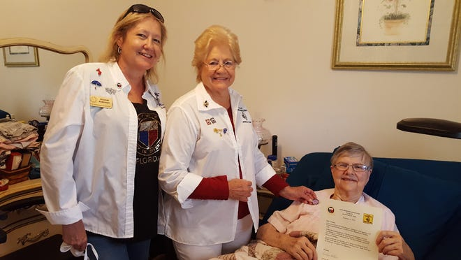 Betty Holloway, a founding member of the GFWC Wewahitchka Woman's Club, is honored for her 65 years of service.