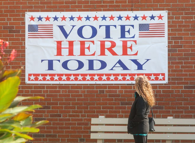 "A photo from 2020 shows a banner announcing ""Vote Here Today"" outside the Portage County Board of Elections offices in Ravenna."