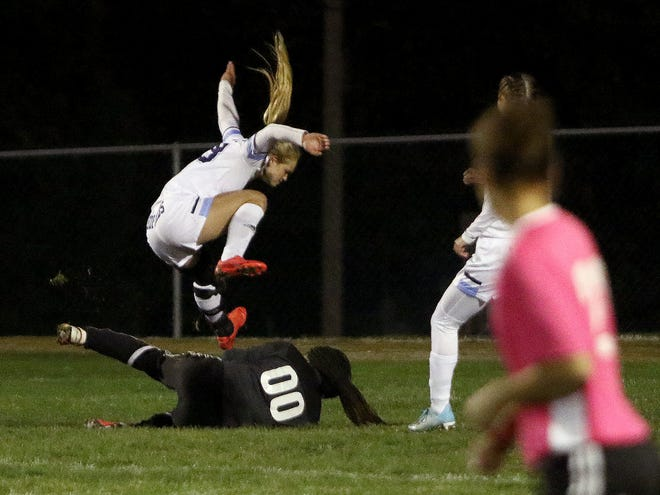 Louisville's Matti Benson leaps over Alliance goalkeeper La'Kasja Edwards during their soccer match at Rockhill field on Monday, October 5, 2020.