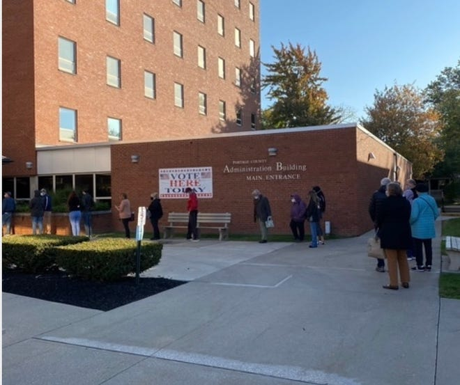 Dozens of people lined up Tuesday morning at the Portage County Board of Elections in Ravenna to cast their ballot on the first day of early voting in Ohio.