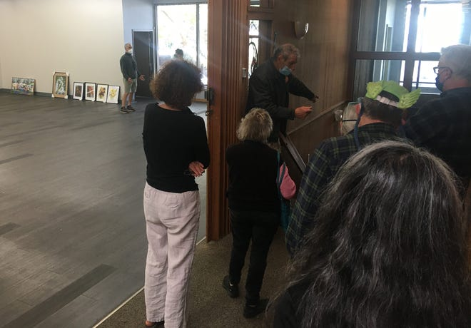 Gallery coordinator Steve LaRiccia shows artists around the new New Zone Space in the Smith Family Building.