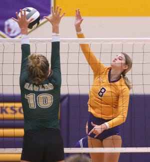Jackson's Ally Woolbert (8) goes for the kill as GlenOak's Brooke Pope (10) defends during their game at Jackson on Monday. (CantonRep.com / Scott Heckel)