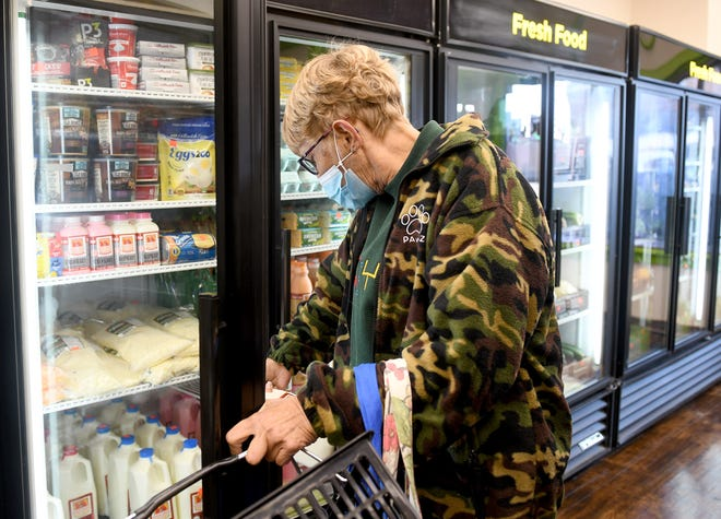 Sandra Reese, of Canton, was one of the first shoppers at the StarkFresh Grocery Store, which opened Tuesday.