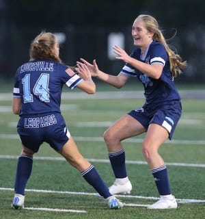 Morgan Keelan (right) of Louisville celebrates her goal with Diana Pukys (14) during their game against Hoover at Louisville on Monday, Sept. 21, 2020. (CantonRep.com / Scott Heckel)