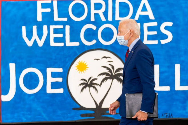 Democratic presidential candidate former Vice President Joe Biden leaves after speaking Monday at Jose Marti in Miami.