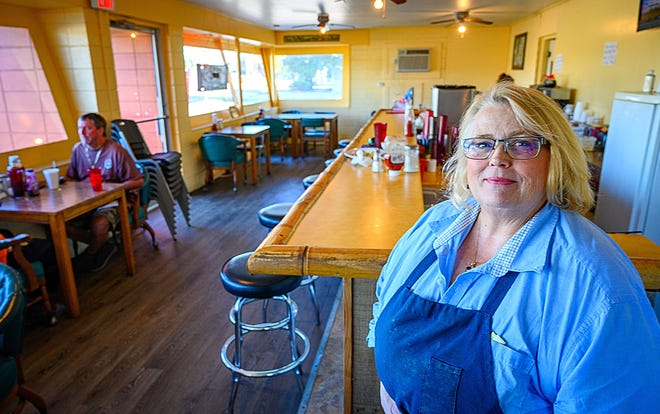 Tammy Osborne, owner of Tammy's Comfort Food in St. Augustine, stands in the dining room of her business on Oct. 1. Osborne increased the seating capacity of the restaurant now that Gov. Ron DeSantis has rolled back restrictions on capacity and face coverings for restaurants, bars, shops and gyms.
