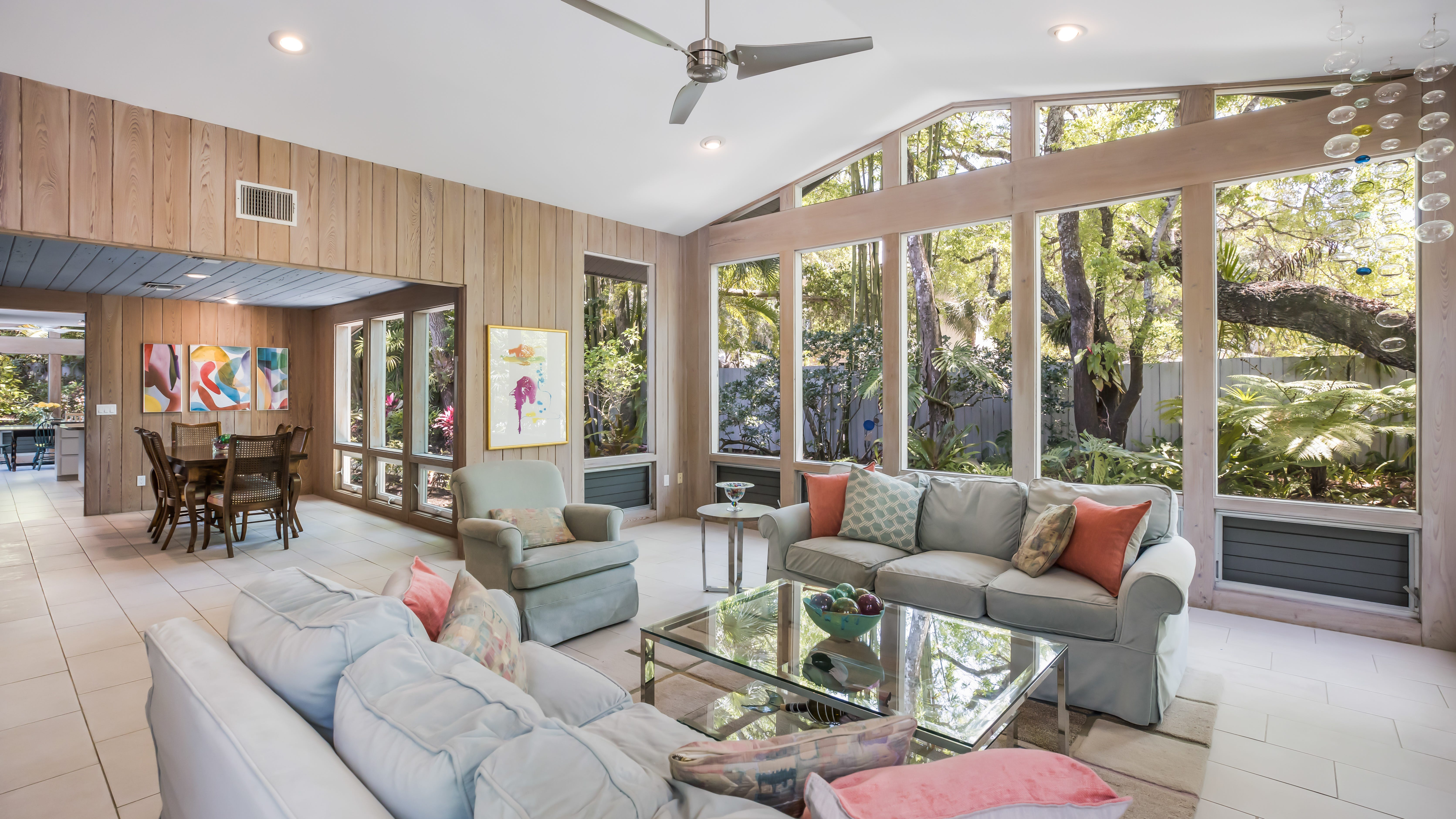 This  has clerestory windows. vintage home for sale on Old Oak in Sarasota is vaulted and there's a fireplace. The walls and ceiling are pecky cypress.