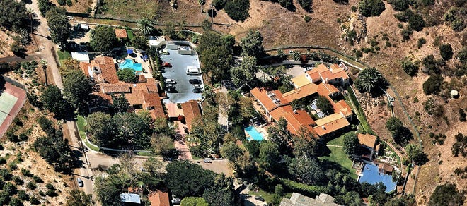 Blockbuster filmmaker James Cameron is seeking $25 million for his two-house compound in a gated Malibu community. The two properties combine for about four acres of grounds, 16,000 square feet of living space, 11 bedrooms, 13 bathrooms and two swimming pools. (NearMap/Handout/Los Angeles Times/TNS)