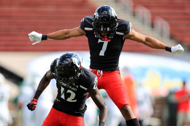 Cincinnati cornerback Ahmad Gardner (12) celebrates making an interception with teammate cornerback Coby Bryant (7) against South Florida on Oct. 3 in Cincinnati. (AP Photo/Aaron Doster)