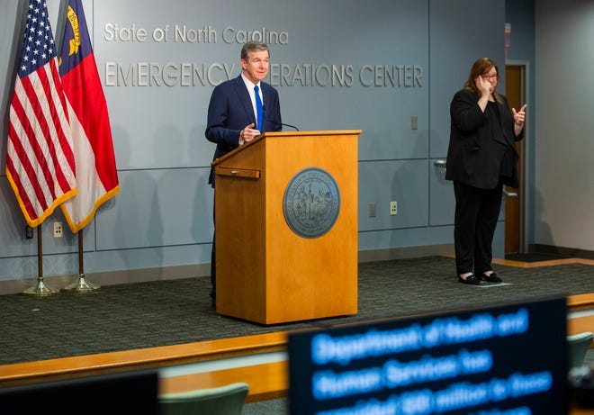 North Carolina Gov. Roy Cooper answers questions during a briefing on North Carolina's coronavirus pandemic response Tuesday, Oct. 6, 2020, in Raleigh, N.C. (Casey Toth/The News & Observer via AP)
