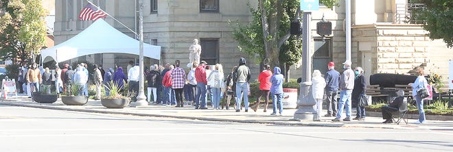 Voters waited in line to cast their ballots on the opening day of voting at the Tuscarawas County Courthouse in New Philadelphia.
