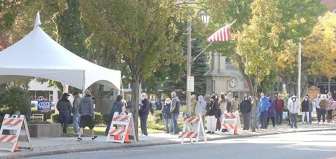 Voters were lined up along N. Broadway and around the corner to the front of the courthouse Tuesday morning.
