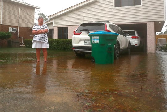 Mary Littleton stands in ankle deep water in her driveway in the Lower Grand Lagoon. She said that she's lived in the area since 1976 and has never experienced flooding like this. Hurricane Sally brought high wind and flooding to dozens of roads and reached up to some homes in Bay County on Sept. 16, 2020.