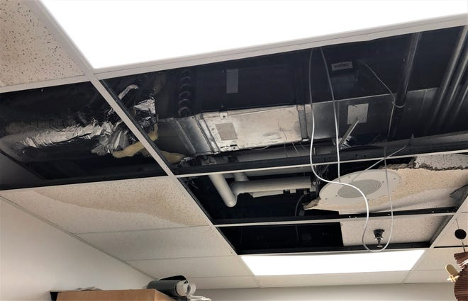 Ceiling tiles damaged by a burst heating coil would be replaced with bond funds.