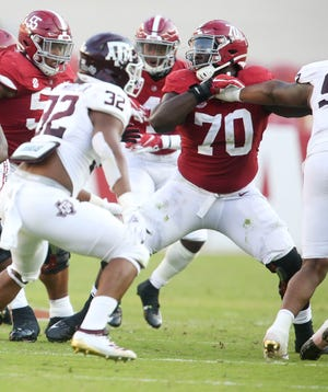 Alabama offensive lineman Alex Leatherwood (70) blocks during Alabama's game with Texas A&M Saturday, Oct. 3, 2020, in Bryant-Denny Stadium. [Staff Photo/Gary Cosby Jr.]