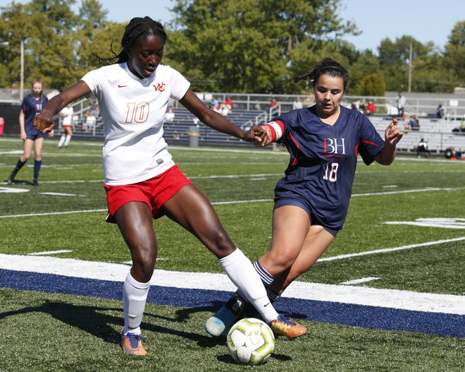 Worthington Christian's Blessing King controls the ball under pressure from Hartley's Olivia Ralston during their game Sept. 19. The Warriors have been relying on their defense this season, including a recent stretch of allowing either zero or one goal in seven consecutive games.