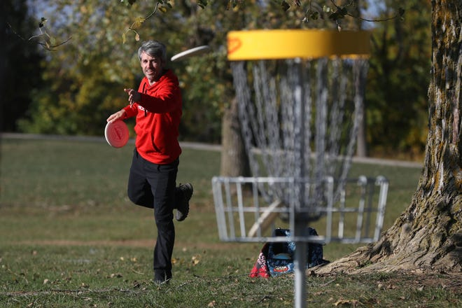 Kyle Mihok of Hilliard lets a disc fly while playing a round of disc golf with friends Oct. 5 on the new 18-hole course at Roger A. Reynolds Municipal Park in Hilliard.