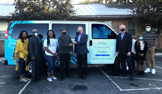 The Second Ward Community Center, 54 Ross St., has a new van purchased with Community Development Block Grant Funds approved by Delaware County. Welcoming the vehicle to SWCC were (from left) SWCC director Karriejoi Coit, SWCC board president Ruchelle Pride, SWCC board vice president Tajudeen Bakare, SWCC board member Harry Hart, Delaware County commissioners Jeff Benton and Gary Merrell, SWCC STEAM Club president Debora Mbatudde and SWCC STEAM Club secretary Kellen Jackson.