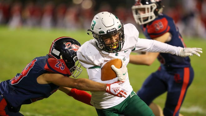 Westland's Zane Gibbs-Aguon runs for a first down Oct. 2 at Grove City.