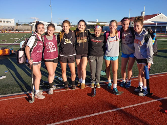 New Albany field hockey players, from left, Meghan Kallner, Abigail Chattos, Olivia Boyles, Olivia Pollack, Bella Thompson, Paige Cornelius, Bridget Driscoll and Catherine Gurd have sparked a stout defensive effort this season.