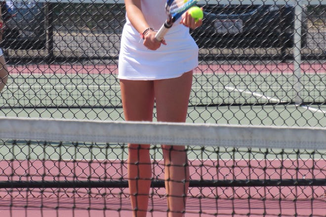 Canal Winchester's Maria Sims prepares to serve during a second-doubles match earlier this season. Sims was one of several varsity newcomers for the Indians, whose season ended Oct. 8 at the Upper Arlington sectional.