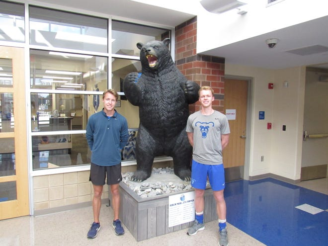 Corey Rinehart, left, and his twin brother, Kyle, are standouts in their respective sports at Berlin. Corey holds the program record for the boys cross country team and program records in the 800 and 1,600 meters in boys track and field. Kyle is a three-year starting defender for the boys soccer team.