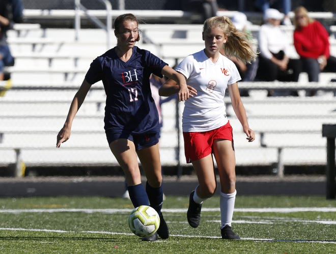 Hartley's Karli Barringer (left) battles Worthington Christian's Audrey Meadows during their game Sept. 19. Barringer scored to give the Hawks a 1-0 victory.