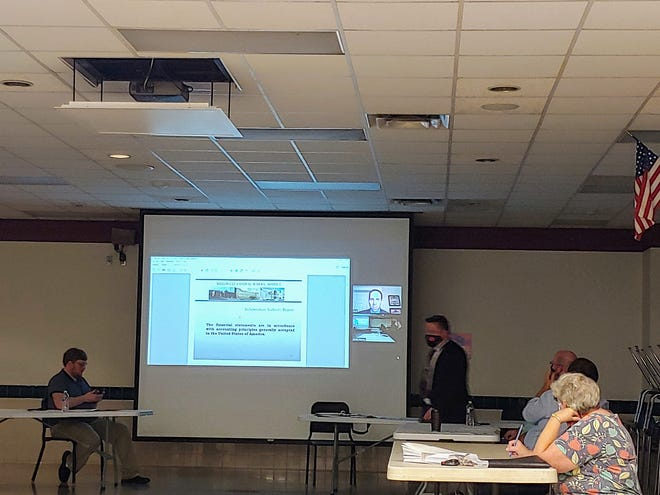 The Wellsville Board of Education receives an audit report via zoom at Monday night's meeting.