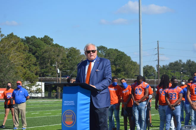 Louisiana College president Dr. Rick Brewer speaks to a crowd at Wildcat Field Monday. LC was accepted into the NAIA and will play in the Sooner Athletic Conference for football and the Red River Athletic Conference for all other sports.