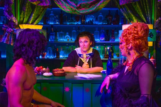 """BenDeLaCreme, center, and Jinkx Monsoon, right, on the set of """"The Jinkx and DeLa Holiday Special,"""" which was filmed in Seattle in September with COVID-19 safety precautions in place."""