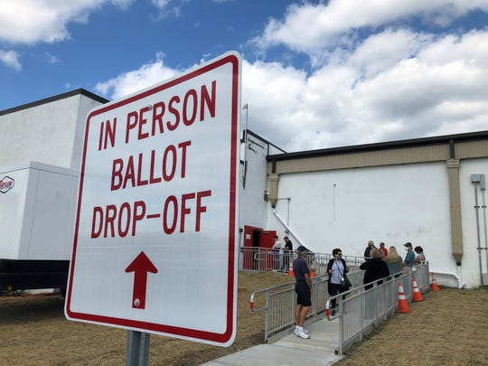 Monmouth County voters lined up to return their vote by mail ballots in person at the Monmouth County Board of Elections office in Freehold, N.J.