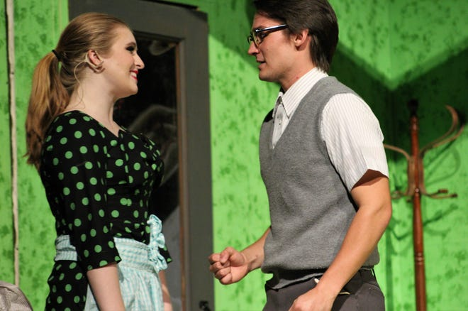 "Juniors Bailee Barrett and Jake Hamilton portray Audrey and Seymour, whose lives entangle further when a blood-loving plant becomes involved in this rehearsal scene from Hardin-Simmons University's musical ""Little Shop of Horrors."""